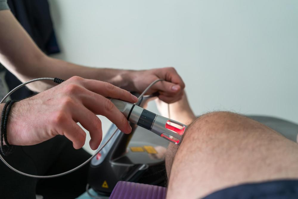 Man getting K-laser treatment on his knee.