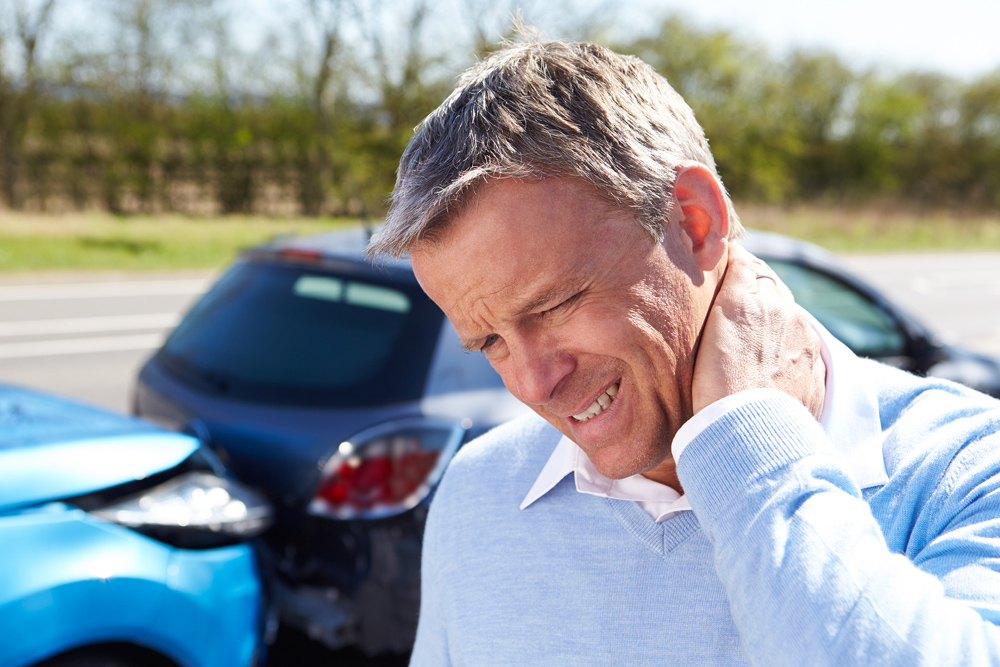 Man with neck pain after a car accident.